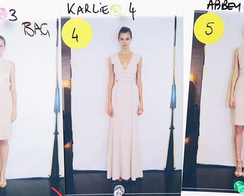 Karlie Kloss lineup board backstage Elie Saab Spring 2012 show